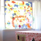 Colored tissue paper collage on window