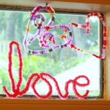 Spelling L-O-V-E with Melted Bead Suncatchers